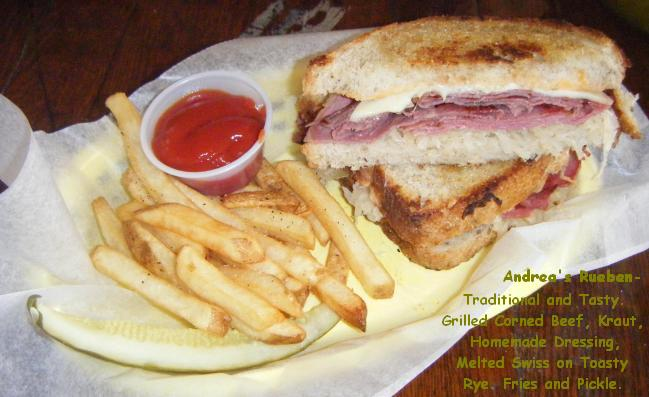 Andrea's Rueben- Traditional and Tasty. Grilled Corned Beef, Kraut, Homemade Dressing, Melted Swiss on Toasty Rye. Fries and Pickle.